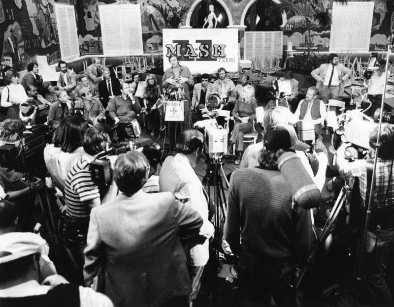Alan Alda, at the podium, addresses production crew, reporters and guests at the wrap party at 20th Century Fox studios