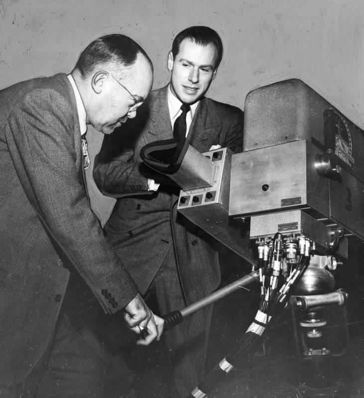 Hilton Tupman and Klaus Landsberg look at a TV camera