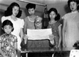 Mr. Chung giving a speech with 5 girls.