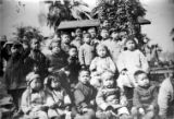 Picnic in Plaza, picture of kids: Back row (from left to right): ?, Bruce Shem, Rose Mary Chu,...