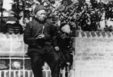 Quon Soong Hoo (the elderly man), sitting with Ernest Young (Howard's brother) on a brick seat