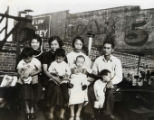 Howard Quon family sitting on a roof on Sanchez Street; pictures three women, one man and four...