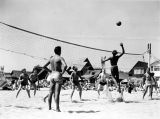 Men playing volleyball on Venice Beach