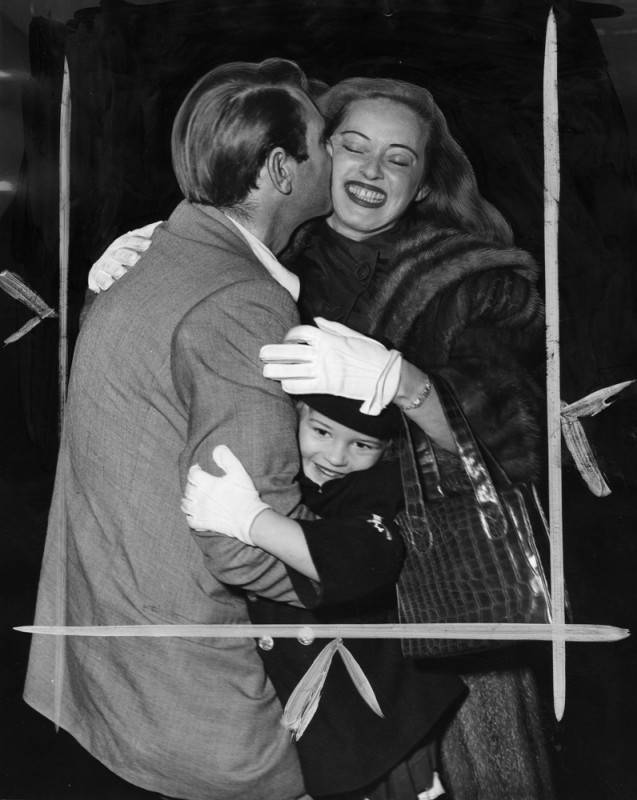 Bette Davis and daughter B.D. greet husband number four, Garry Merrill at the airport