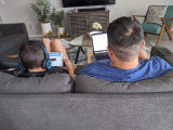Father and son telecommuting due to the 'Safer at Home' order during the COVID-19 pandemic