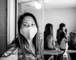 Woman wearing a face mask before leaving home to do errands during the COVID-19 pandemic