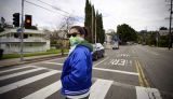 Woman wearing a mask on a neighborhood walk during the COVID-19 pandemic