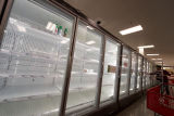 Row of empty freezer cases at a Target store during the COVID-19 pandemic