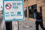 Crosswalk sign to discourage touching the signal button on Hollywood Boulevard during the COVID-19...