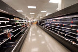 Aisle of empty produce shelves at a Target store during the COVID-19 pandemic