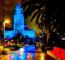 Los Angeles City Hall lit up with blue lights at night