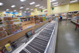 Aisle of empty freezer cases at Trader Joe's during the COVID-19 pandemic