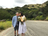 Couple kissing in Griffith Park on their wedding day during the COVID-19 pandemic