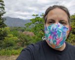 Self-portrait of a woman wearing a face mask at the Los Angeles County Arboretum during the...
