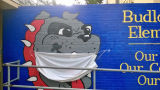 Face mask added to a mural of Budlong Elementary School mascot during the COVID-19 pandemic