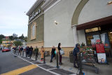 Long line outside of a Gelson's supermarket during the COVID-19 pandemic