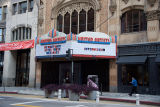 Man walks by the United Artists Theatre during the COVID-19 pandemic