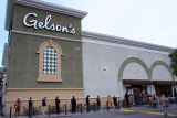Line to enter Gelson's supermarket wraps around the building during the COVID-19 pandemic