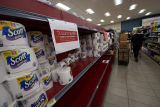 Gelson's supermarket aisle with signs indicating buying limits on toilet paper