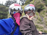 Self-portrait of a couple wearing masks, gloves, and helmets