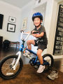 Boy exercising on a bicycle inside his home
