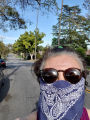 Woman wearing bandanna face covering while exercising outdoors