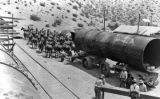 20-mule team hauling large section of penstock
