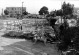 Photograph taken of parking lot number two on Main Street, sectioned off with barricades