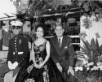 Olvera Street fountain with Consuelo de Sousa and two unidentified men in front of the fountain