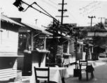 Photograph of booths and small dining tables outside of a cafe on Olvera Street