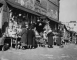 Photograph of ladies outside of booths along Olvera Street
