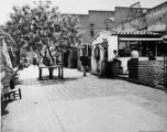 Photograph of people walking along Olvera Street
