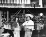 Actress Betty Furness with Francisco Gonzales in a candle shop in the basement of Sepulveda Block.