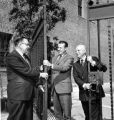 Hubert Laughen and Hernando Courtright are opening the Sanchez Street iron gate