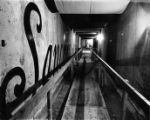 Photograph of the Merced Garnier building looking from Merced through the Sanchez Street tunnel to...