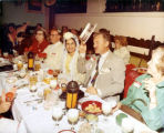 Group of people sitting at Mardi Gras dinner