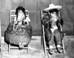 Children in chairs drinking