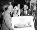 Consuelo de Bonzo, John Anson Ford, and Edward R. Roybal with a drawing of the Simpson building at...