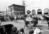 Horses turning corner of Main and Sunset in Blessing of the Animals procession