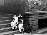 Four children on steps of 920 Sacramento