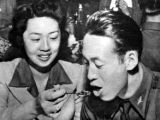 At dinner in the cadet mess hall, Margaret Kwong fed her last spoonful of dessert to Shih...
