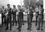 Mariachis playing on the balcony of the Biscailuz building