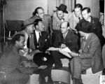 Victor Quon with Jimmy Durante, Fred Allen, and Bob Hope.  AFRS staff photo (on lower right corner)