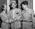 Major Victor Quon with Bing Crosby and a writer