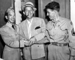 Major Victor Quon with Bing Crosby and a writer- 1945