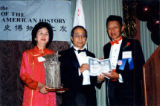 Photo of Dan Louie Jr. presented an award to All Soo Hoo.