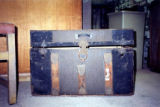 Photograph of an old suitcase from the See family.