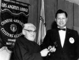 Y.C. Hong and Fred H. Chung are both holding the gavel at the Chinese American Citizen's Alliance,...