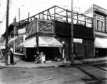 600 Block of North Spring Street. Railroad lines are on the paved road. There is a Yuen Kee...