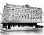 Photograph of Jennette Block on Los Angeles Street, which the Hotel de Paris occupied. There is a...